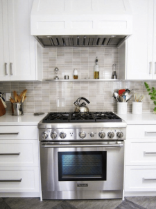 Floating shelves above the stove for small kitchen