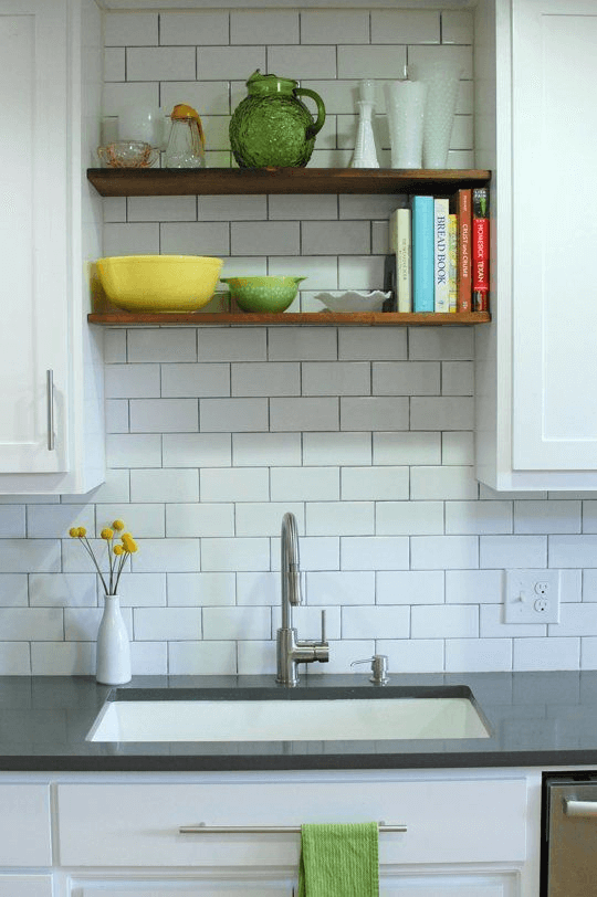Small kitchen floating shelves above sink