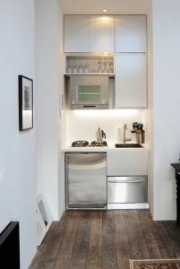 Very small kitchen basement with compact cabinet