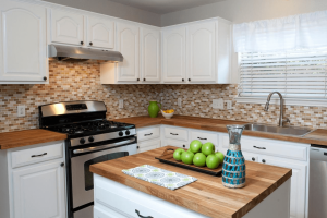 Small kitchen remodel ideas on a budget with adding butcher blocks, countertops, kitchen islands