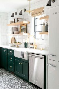 DEEP GREEN CABINET IN WHITE APARTMENT KITCHEN