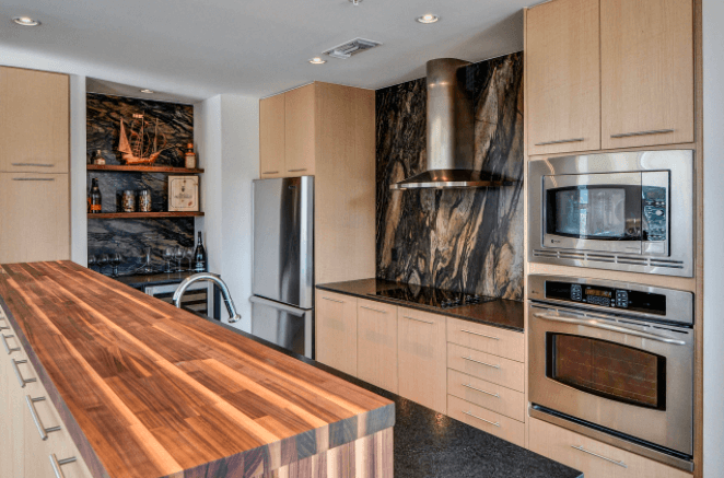 Gather the Microwave with the Oven as a Stainless Steel Area in the Kitchen