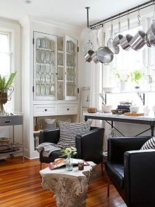 HANG POTS AND PANS IN FRONT OF THE WINDOW RACK IN SMALL KITCHEN
