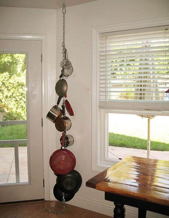 HANG POTS AND PANS WITH HANGING ROD IN SMALL KITCHEN
