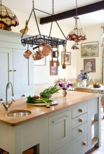 MEDIEVAL STYLE HANG POTS AND PANS IN SMALL KITCHEN