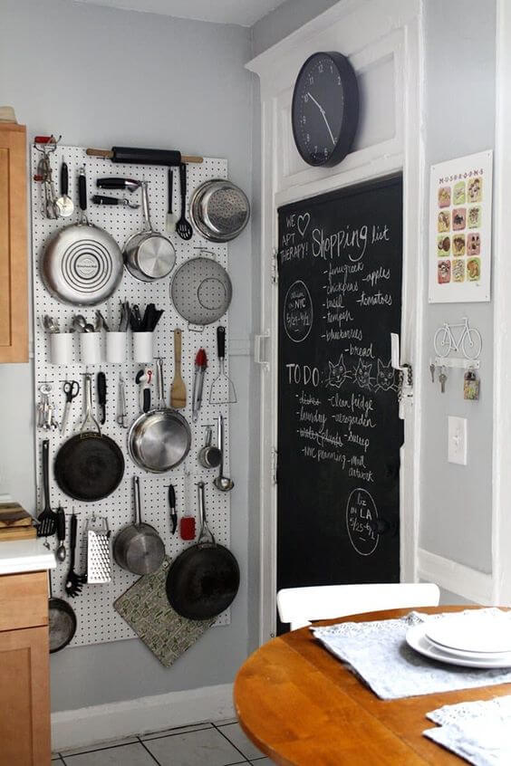 THE PEGBOARD RACK FOR HANG POTS AND PANS IN SMALL KITCHEN