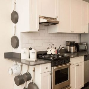 HOW TO STORE POTS AND PANS IN A SMALL KITCHEN. EVERYWHERE A HOOK