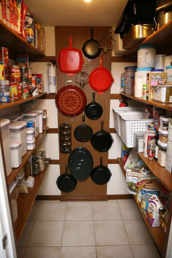 HOW TO STORE POTS AND PANS IN A SMALL KITCHEN. HANG THEM IN THE PANTRY