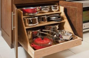 ROLL OUT CABINET ORGANIZER TO STORE POTS AND PANS IN A SMALL KITCHEN