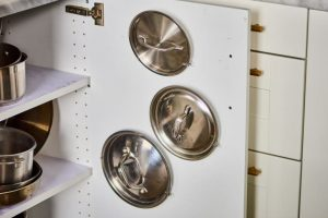 SEPARATE THE LIDS TO STORE POTS AND PANS IN A SMALL KITCHEN