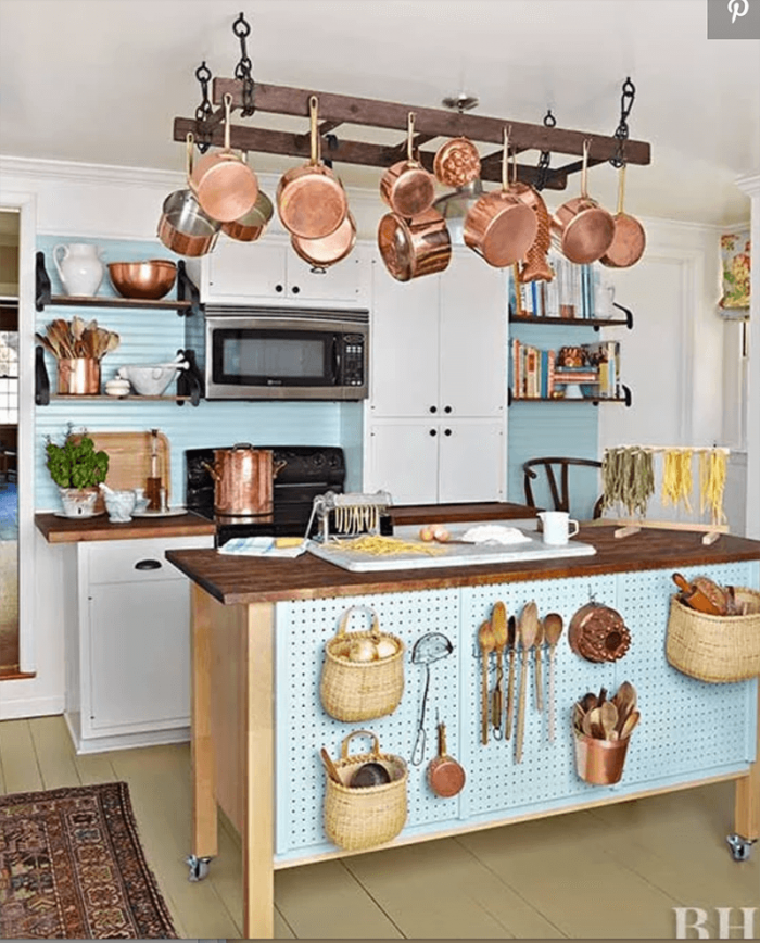 THE HANG LADDER TO STORE POTS AND PANS IN A SMALL KITCHEN