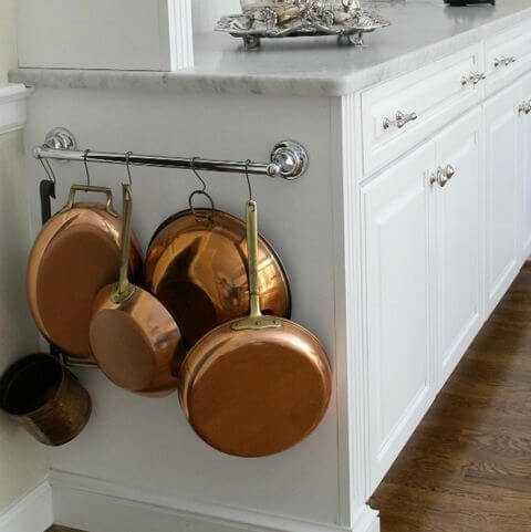 TOWEL BAR TO STORE POTS AND PANS IN A SMALL KITCHEN